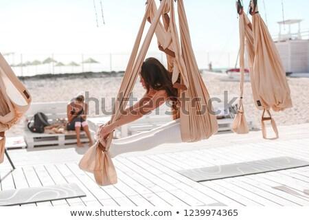 Bela mulher comprometido ioga ao ar livre mar praia Foto stock © ElenaBatkova