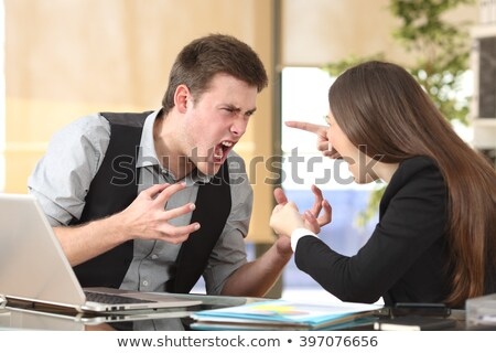 angry businessman shouting at female executive stock photo © andreypopov