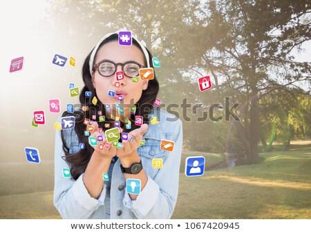 Jovem mulher aplicação ícones Foto stock © wavebreak_media