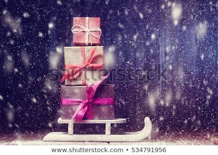 Wooden sledges with gift box Stock photo © montego