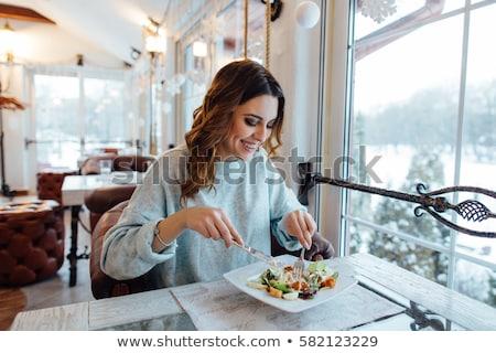 smiling woman at restaurant Stock photo © dolgachov