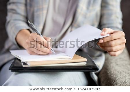 Tijdgenoot jonge leraar pen papier een Stockfoto © pressmaster