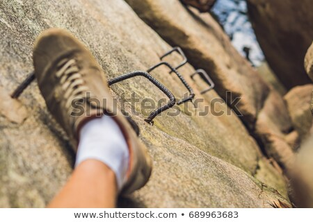 Bacaklar gezgin kaya demir merdiven seyahat Stok fotoğraf © galitskaya