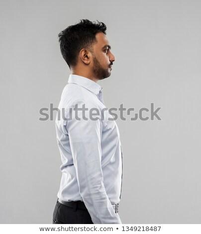 indian businessman side view over grey background Stock photo © dolgachov