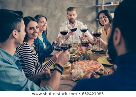Znajomych jedzenie pizza pitnej wino czerwone domu Zdjęcia stock © dolgachov