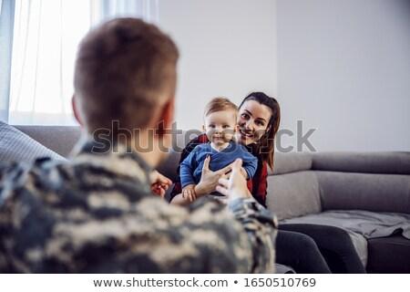 Człowiek umiłowany żona dziecko broni rodziny Zdjęcia stock © ElenaBatkova