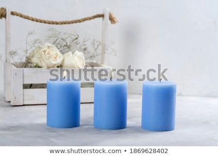 Blue aromatic candle on Christmas and New Years glitter backgrou Stock photo © Anneleven