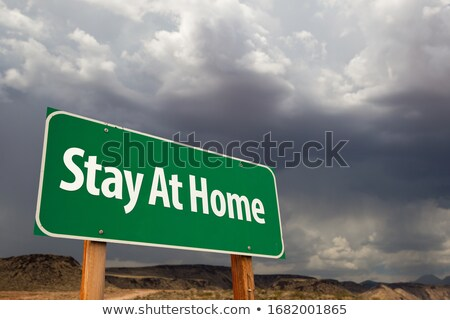 #COVID19 Green Road Sign Against An Ominous Cloudy Sky Stock photo © feverpitch