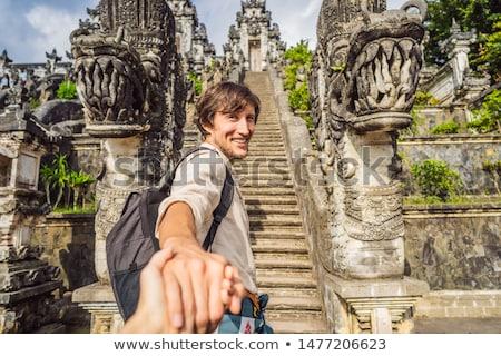 follow me photo. Young man tourist on background of Three stone ladders in beautiful Pura Lempuyang  Stock photo © galitskaya