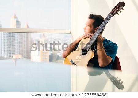 Musician With Guitar Feeling Uninspired And Lacking Creativity Stock photo © diego_cervo
