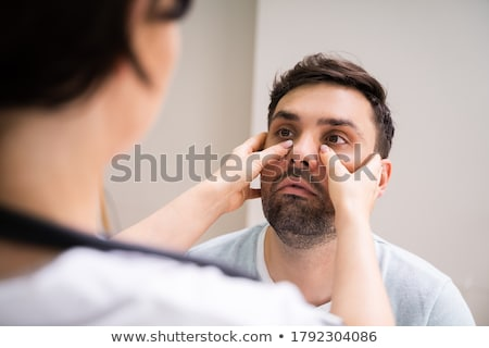 Physician Doctor Doing Sinusitis Examination Stock photo © AndreyPopov