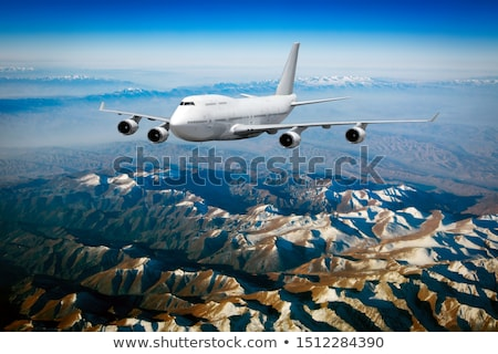 repülőgép · szárny · felhők · kilátás · repülőgép · tiszta · égbolt - stock fotó © phbcz