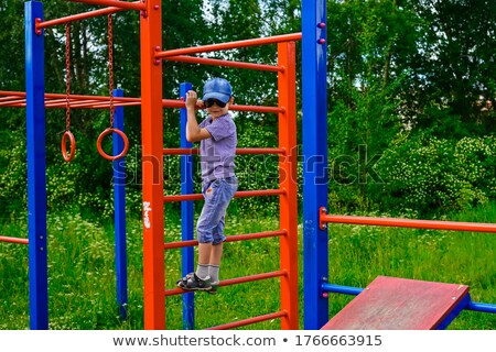 Toddler walking amoung a playground Stock photo © Frankljr
