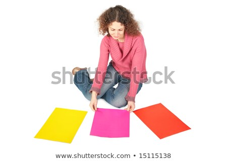 young woman sits on floor with three multi-coloured sheets of paper stock photo © Paha_L
