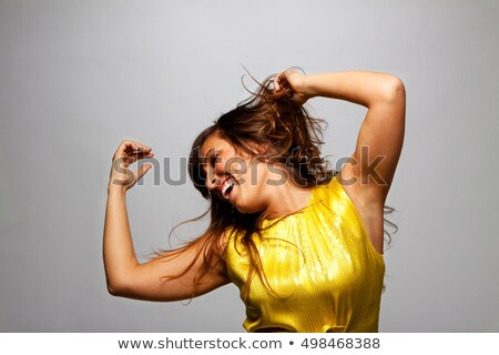 Stock photo: Young carefree woman flicking hair