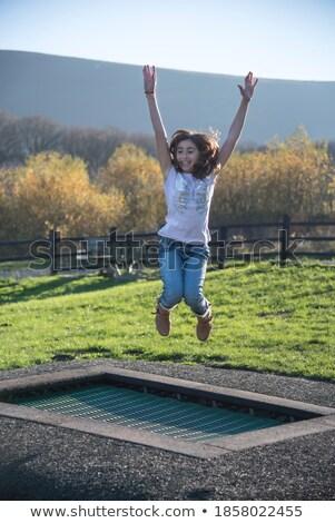 alto · voador · saltar · alegria · beautiful · girl · parque - foto stock © darrinhenry