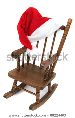 Old Wooden Rocking Chair With Red Jelly Bag Cap Stock fotó © pterwort
