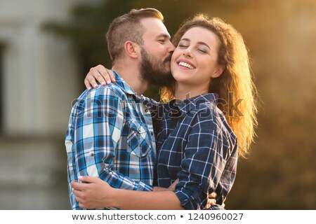 Husband kissing his wife Stock photo © photography33