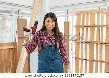 Handywoman in overalls Stock photo © photography33