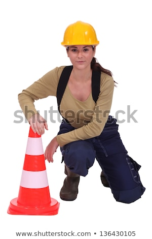 Woman kneeling by traffic cones Stock photo © photography33