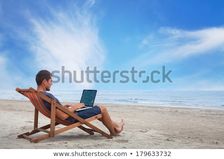 Computer notebook on beach - business travel background Stock photo © ozaiachin