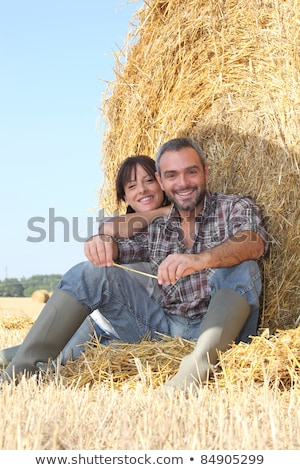 Farmer and wife sat on hay bale Stock photo © photography33