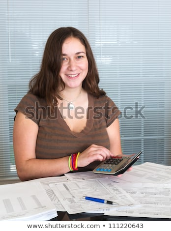 young lady preparing usa tax form 1040 for 2012 stock photo © backyardproductions