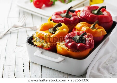 stuffed red and yellow bell peppers stock photo © zhekos