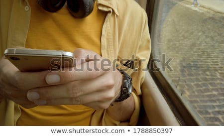 Hombre equitación tranvía móviles teléfono paisaje Foto stock © photography33