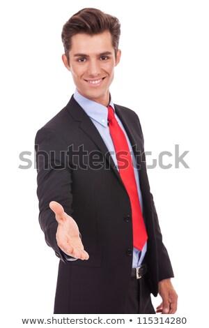 business man wlecoming you with a handshake  stock photo © feedough