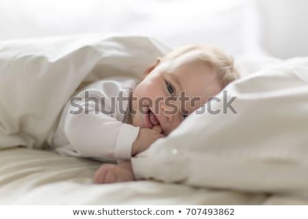 cute little baby infant toddler on white blanket portrait Stock photo © juniart