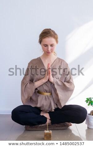 Fiatal nő égő aromás bot ül padló Stock fotó © HASLOO