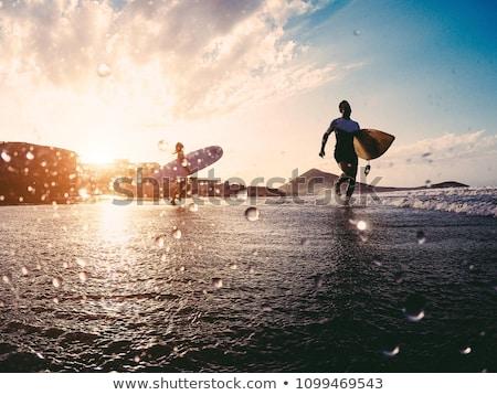 surfer girl   body surfing beach woman laughing stock photo © maridav