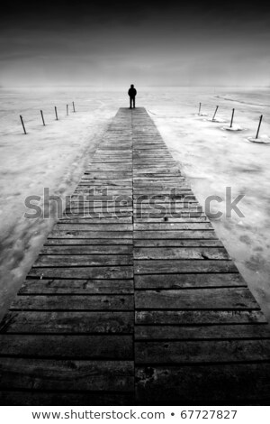 wooden pier with a man , black and white Stock photo © leungchopan