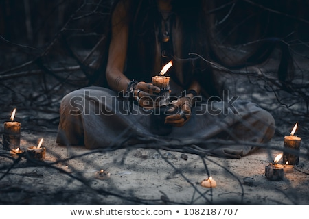 Mysterious young woman with a candle in hands Stock photo © Andersonrise