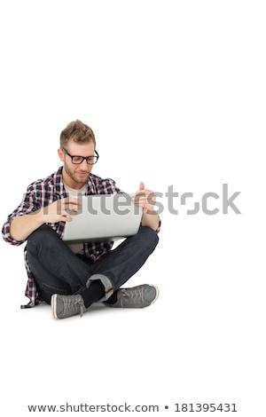 Fiatalember laptop lábak keresztbe ül padló férfi Stock fotó © Kzenon