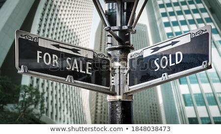 Sold signpost Stock photo © burakowski