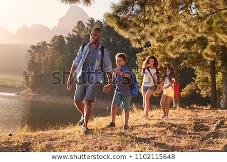 father and son hiking in countryside stock photo © monkey_business