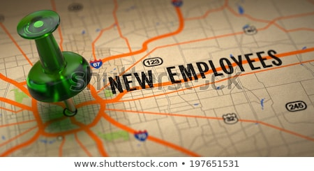 New Employees - Green Pushpin on a Map Background. Stock photo © tashatuvango