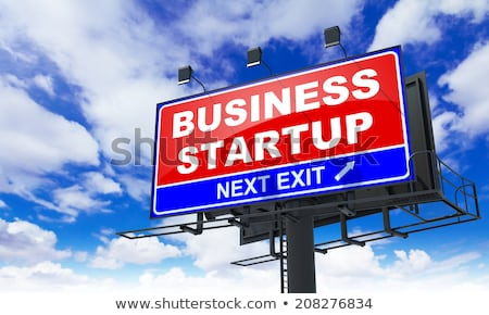 startup inscription on red billboard stock photo © tashatuvango