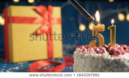 Birthday cake with burning candle number 51 Stock photo © Zerbor