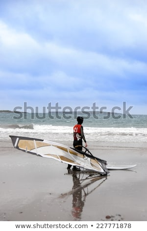 lone Atlantic windsurfer getting ready to surf Stock photo © morrbyte