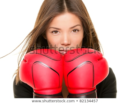 beautiful businesswoman wearing boxing gloves punching isolated on white background stock photo © deandrobot