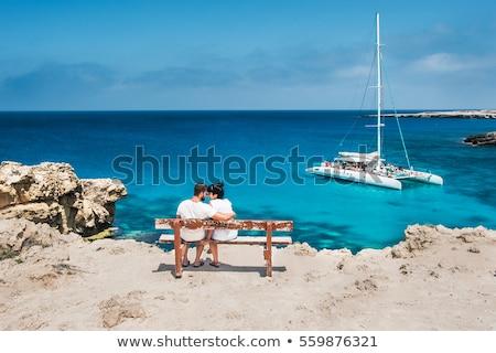 Recém-casados casal sessão água praia romântico Foto stock © dariazu