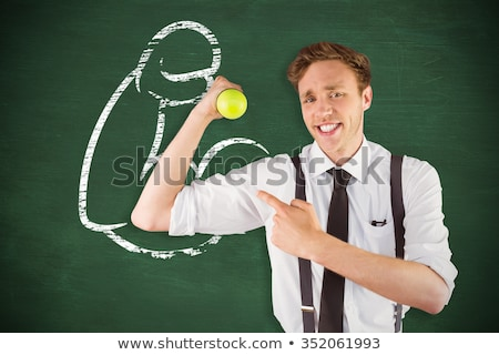Geeky happy businessman lifting dumbbell Stock photo © wavebreak_media
