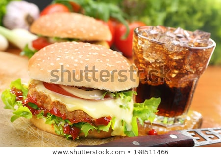 Homemade Hamburger with Fresh Vegetables and Drink with Ice Stock photo © Kayco