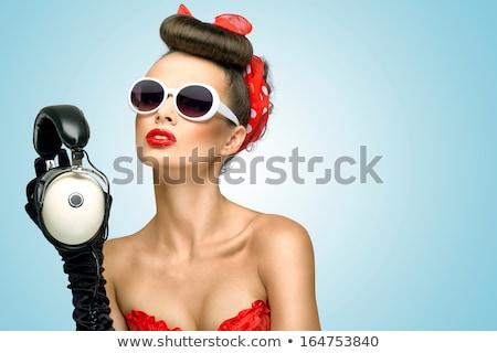 Pinup dziewczyna okulary uśmiechnięty piękna Zdjęcia stock © NeonShot