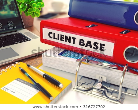 Client Base on Red Office Folder. Toned Image. Stock photo © tashatuvango