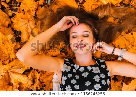 Dreamy girl with dry leaves Stock photo © Anna_Om