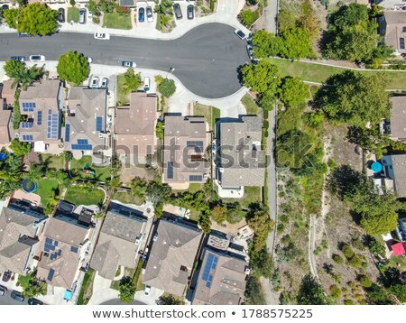 Contemporary Neighborhood Roof Tops with Solar Panels Stock photo © feverpitch